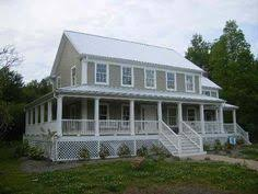 Farmhouse With Wrap Around Porch Farm House Love Wrap Around Porch White Paint Hanging Ivy