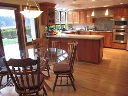 Hardwood Floors In Kitchens Craftsman Kitchen With Kitchen Peninsula U0026 Skylight In Bellevue