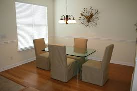 formal dining with beautiful banboo flooring crown and chair rail