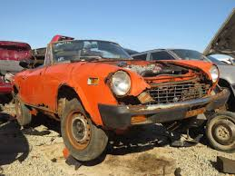 rusty car driving junkyard find 1976 fiat 124 sport spider the truth about cars
