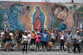 boyle heights beat bicyclists highlight the murals and history erik huerta and maryann aguirre two of the organizers of the eastside mural ride
