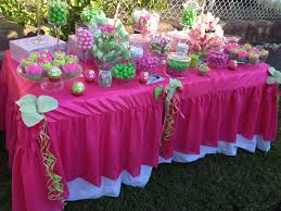 pink and ljme green candy table for a baby shower baby showers