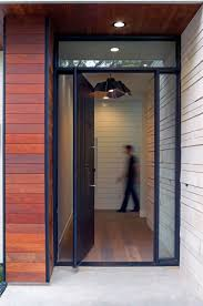 modern house door a contemporary house with peaked roofs arrives on this street in