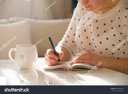 Nice Coffee Cups by Woman Sitting Table Writing Notebook Drinking Stock Photo