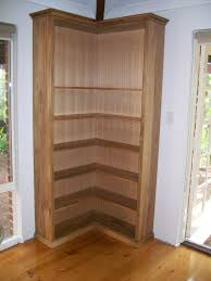 Wooden Shelf Design Plans by Double Sided Wood Corner Bookcase Design Decofurnish