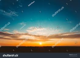 natural sunset sunrise over field meadow stock photo 560553487