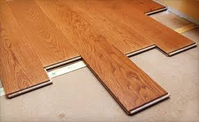 up to 75 installed laminate flooring or rugs from