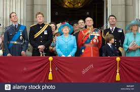 the queen and members of the royal family on the balcony of stock