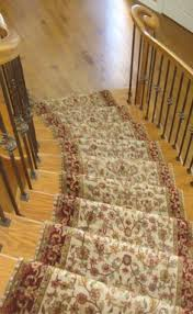 red oriental patterned stair runner walls stair rods and oriental
