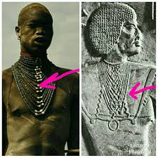 information on egyptain hairstlyes for and ancient egyptian man wearing what looks like a dinka beaded amulet