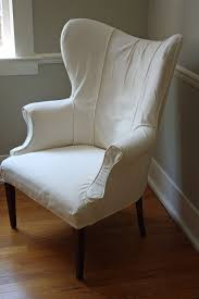 Winged Chairs Design Ideas Awesome White Color Wing Chair Design Ideas With Brown Laminated