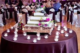 eggplant colored table linens linens chiavari chairs wall draping led lighting cake head table