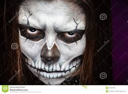 young woman in day of the dead mask skull face art stock photo