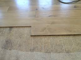 Laying Carpet On Laminate Flooring Can I Lay Wooden Floor Over Carpet Carpet Vidalondon