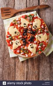 halloween food pizza with ghosts and spiders close up on the