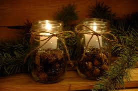 casual picture of glass jar candle holder pine cone wedding