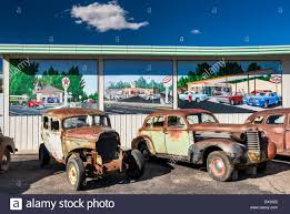 old rusted cars for sale murals behind on wall of service old rusted cars for sale murals behind on wall of service station in delta colorado usa