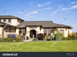 modern house front entrance green grass stock photo 111165875
