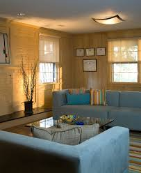 white painted wood paneling basement eclectic with beige curtains
