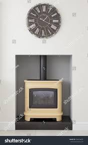 modern kitchen clocks contemporary yellow wood burning stove clock stock photo 106624874