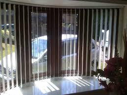 decorating window decor with vertical white levolor blinds