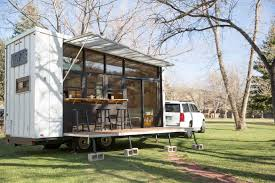 gorgeous tiny home on wheels blends midcentury and boho style in