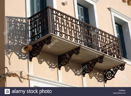 neoclassical iron balcony ornaments of neoclassical mansions and