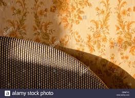 old home interior design part of bed and wall with wallpaper
