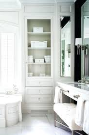 tub cabinet replacement linen cabinet with glass doors wainscoted tub with glass door inset