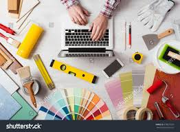 Professional Decorators by Professional Decorators Hands Working His Desk Stock Photo