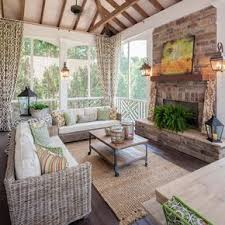 two story double porch with outdoor fireplace travertine patio