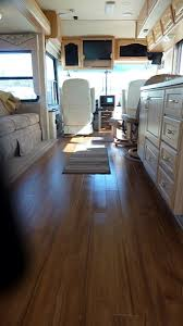 luxury vinyl plank installed in a rv shop these kind of floors at
