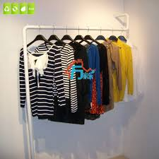 clothing rack clothing store display shelf hangers wall floor wall