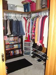 minimalist white color scheme walk in closet wardrobe design with