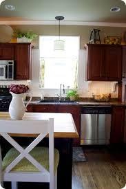 Decor Above Kitchen Cabinets 25 Best Cabinet Top Decorating Ideas On Pinterest Farmhouse