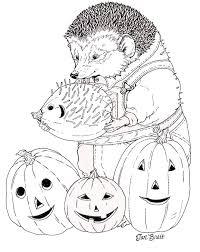 hedgie carves halloween pumpkin