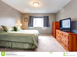 Grey Bedroom Dressers by Large Grey Bedroom With Dresser Tv And Blue Curtains Stock Image