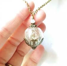 dandelion seed glass orb terrarium necklace with an opalescent