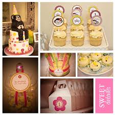 pink and yellow desserts for first birthday party dessert table