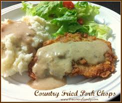 delicious country fried pork chops with a crispy breading see