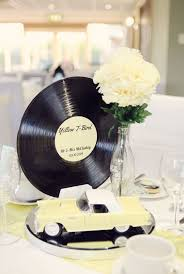 alternative themed wedding ideas  unique pastiche events with s rockabilly centerpiece with vintage car coke bottle and record   featured on rock from uniquepasticheeventscom