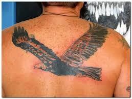 crazy flying eagle tattoo design make on upper back for men