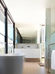 cliff top house luigi rosselli architects frameless glass window modern ensuite