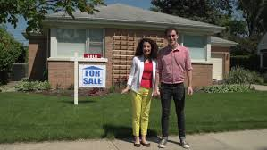 happy young couple standing outside a sold house stock footage