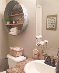 beige wall color with antique wall decor for elegant bathroom