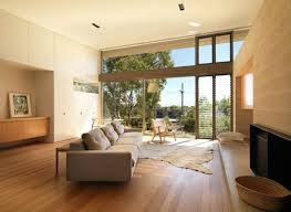 medium hardwood living room ideas grey hardwood floors living room white dotted fabric comfy sofa glass vase cozy decorating ideas