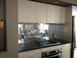 mirror tile backsplash kitchen silver mirror subway tile brighten and open up the space in this