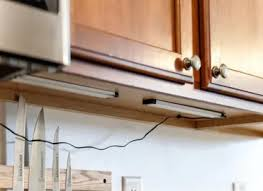 how to install lighting your kitchen cabinets how to add kitchen cabinet lighting in just 30 minutes