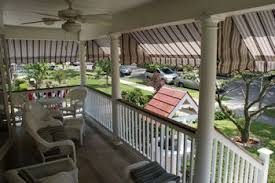 porch awnings let you sit outside in the afternoon shaded from the