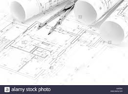 rolls of architectural blueprints and floor plan with drawing